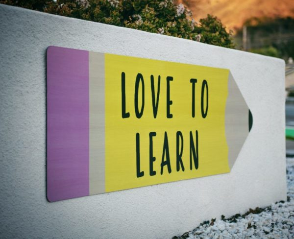 panneau d'indication Love to learn